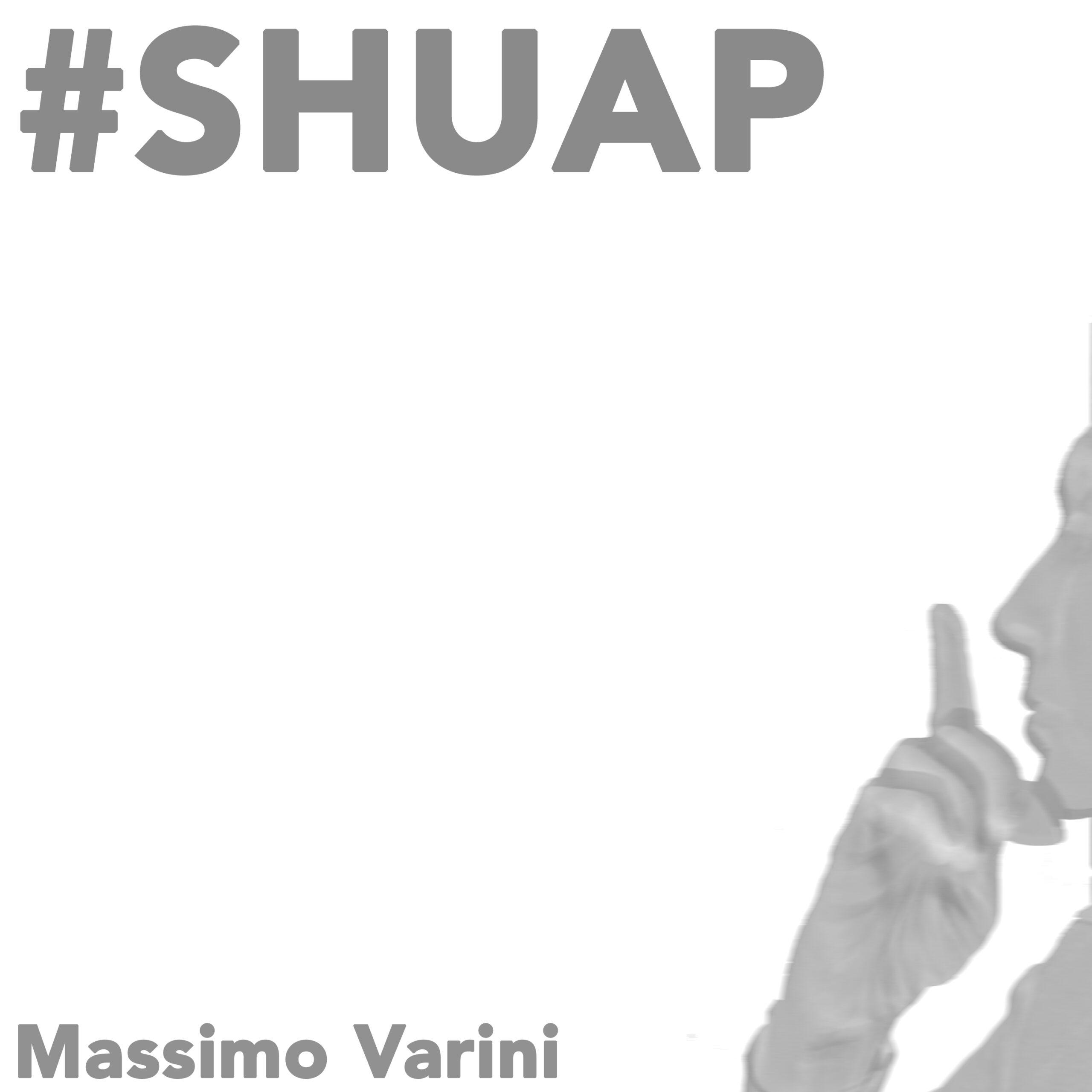 copertina SHUAP che ha il titolo, il nome e una foto raffigurante Massimo Varini con in mano un plettro che con il dito vicino a bocca e naso fa segno di fare silenzio: shut up and play significa: non parlare e suona!